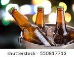 cold bottles of beer in bucket... | Shutterstock . vector #550817713