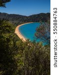 Small photo of Beautiful ocean bay with golden sandy beach in Abel Tasman National Park, New Zealand South Island