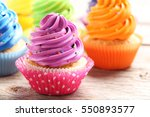 tasty cupcakes on a grey wooden ... | Shutterstock . vector #550893577