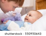 six year old toddler sharing... | Shutterstock . vector #550950643