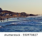 Surfers At Sunset In Bat Yam.