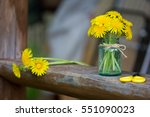 Yellow Wildflowers In A Glass...