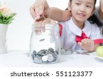 asian little girl in thai... | Shutterstock . vector #551123377