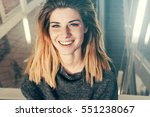 portrait of smiling positive... | Shutterstock . vector #551238067