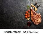 succulent grilled tomahawk beef ... | Shutterstock . vector #551260867