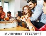 group of young friends eating... | Shutterstock . vector #551270947