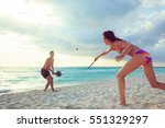 young couple playing beach... | Shutterstock . vector #551329297