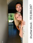 happy young couple welcoming... | Shutterstock . vector #551381287