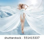 beautiful girl in blowing dress ... | Shutterstock . vector #551415337