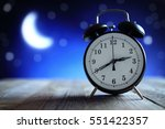 alarm clock in the middle of... | Shutterstock . vector #551422357