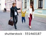 parents with son walking in the ... | Shutterstock . vector #551460187