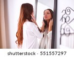 young woman looking herself... | Shutterstock . vector #551557297