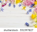 Flowers On White Wooden...