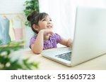 little asia girl using digital... | Shutterstock . vector #551605723