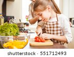 young teenage girl cooking... | Shutterstock . vector #551712493