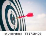 red dart arrow hitting in the...   Shutterstock . vector #551718403