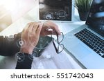 designer businessman hand using ... | Shutterstock . vector #551742043