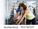 senior couple in gym working... | Shutterstock . vector #551744137