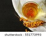 tea with a sea buckthorn.... | Shutterstock . vector #551773993