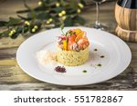 risotto with seafood. rice in... | Shutterstock . vector #551782867