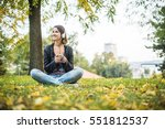beautiful girl sitting on the...   Shutterstock . vector #551812537