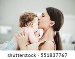 loving mother kissing her baby... | Shutterstock . vector #551837767