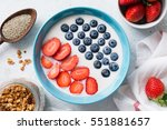 fruit smoothie bowl with... | Shutterstock . vector #551881657