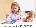 little girl treats a bear ... | Shutterstock . vector #551888953