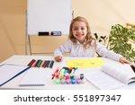 beautiful little girl cutting... | Shutterstock . vector #551897347
