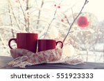 pair of red cups in a warming... | Shutterstock . vector #551923333