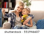 young woman with daughter...   Shutterstock . vector #551946607