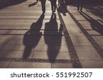 silhouettes of people walking... | Shutterstock . vector #551992507