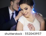 loving man putting necklace on... | Shutterstock . vector #552043957