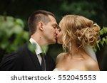 wedding kiss  close up portrait ... | Shutterstock . vector #552045553