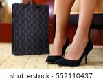 woman buying new shoes. closeup ...   Shutterstock . vector #552110437