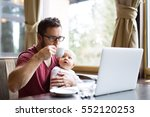man with notebook in cafe... | Shutterstock . vector #552120253
