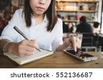 young woman writing in the... | Shutterstock . vector #552136687