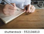 woman writing in the notebook. | Shutterstock . vector #552136813