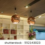 golden ceiling lampshades in a... | Shutterstock . vector #552143023