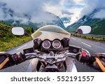 biker driving a motorcycle... | Shutterstock . vector #552191557