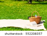 blanket and a basket of fruit... | Shutterstock . vector #552208357