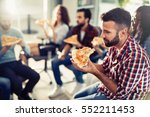 coworkers eating pizza during... | Shutterstock . vector #552211453