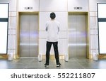 man in jeans and hat standing... | Shutterstock . vector #552211807