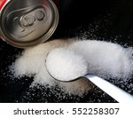 Spoon Of White Sugar With Soda...