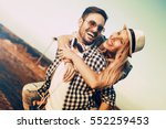 happy loving couple embracing... | Shutterstock . vector #552259453