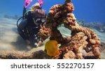 woman scuba diver diving and... | Shutterstock . vector #552270157