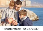 father reading a book to his... | Shutterstock . vector #552279337