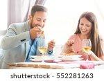 happy couple enjoying food in... | Shutterstock . vector #552281263