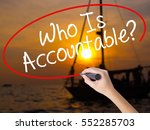 Small photo of Woman Hand Writing Who Is Accountable? with a marker over transparent board. Isolated on Sunset Boat. Business, technology, internet concept. Stock Image