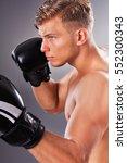portrait of handsome muscular... | Shutterstock . vector #552300343